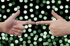 把手指指向彼此 免版税库存照片