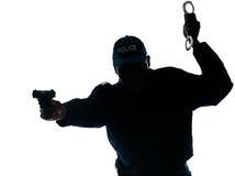 把手枪官员警察扣上手铐 库存照片
