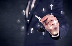 把握与钥匙的商人关键 库存图片