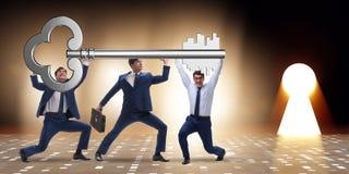 把握在企业概念的商人巨型关键 库存照片