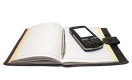把柄位于的移动笔记本电话 免版税图库摄影