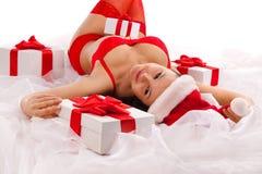 把礼品女孩性感的圣诞老人装箱 库存图片