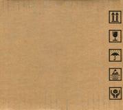 把纸板符号装箱 免版税库存图片