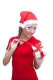 把辅助工快乐的openning的当前圣诞老人装&# 库存照片