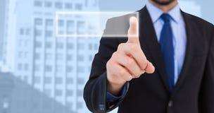 把他的手指指向的商人的综合图象照相机 免版税库存图片