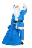 把他的手指指向的蓝色圣诞老人对象 免版税库存图片