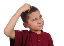 抓认为的男孩混淆的题头 免版税库存图片