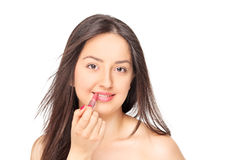 投入在一支红色唇膏的美丽的妇女 免版税库存图片