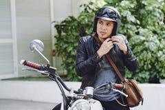 投入在摩托车盔甲 库存图片