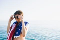 投入在游泳风镜的湿头发的妇女 免版税库存图片