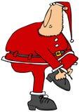 投入在他的起动的圣诞老人的帮手 免版税库存照片