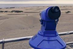 投入硬币后自动操作双眼看沙子沙漠dunas 免版税库存照片