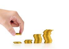 投入硬币的手人的手对金钱 免版税库存照片