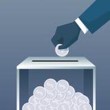 投入硬币的手捐赠慈善贡献的箱子 库存图片