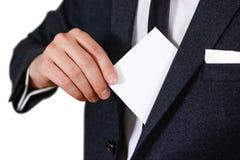 投入纸的商人在衣服口袋特写镜头 显示空白 库存图片