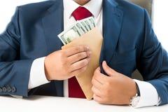 投入金钱的被贿赂的人概念性照片在衣服口袋 免版税库存图片