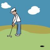 投入高尔夫球的假期人 免版税图库摄影