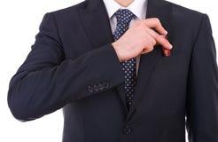 投入usb棍子的商人在他的口袋。 图库摄影