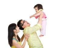 投掷空气的父亲小女儿 免版税库存照片