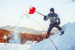 投掷雪铁锹 库存照片