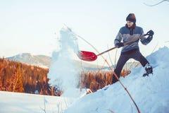 投掷雪铁锹 免版税图库摄影