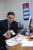 投资经理的货币办公室对 免版税库存图片