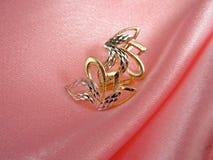 折叠玫瑰色金黄的珠宝 图库摄影