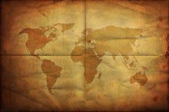 折叠的grunge映射老纸世界 免版税库存照片