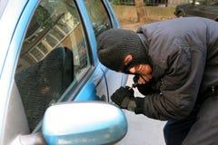 抢劫汽车 图库摄影
