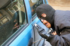 抢劫汽车 免版税库存图片