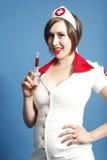 护士性感的注射器 免版税库存照片
