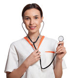 护士或拿着听诊器的医学学生 免版税库存照片