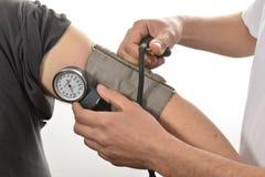 护士监视血压 免版税库存照片