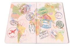 护照盖印与各种各样的国家的背景 特写镜头 库存照片