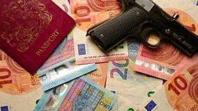 护照金钱和一杆黑枪 库存照片