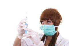 护理与一根注射器和针在手上 图库摄影