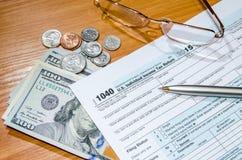 1040报税表在2016年与美元和笔 免版税库存图片