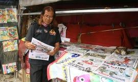 报纸卖主 免版税库存图片