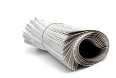 报纸卷起了 免版税库存照片