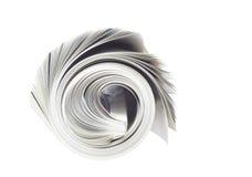 报纸卷起了 免版税库存图片