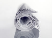 报纸卷起了 免版税图库摄影