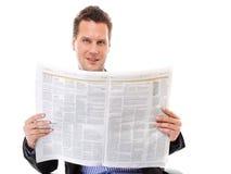 读报纸的商人被隔绝 免版税图库摄影