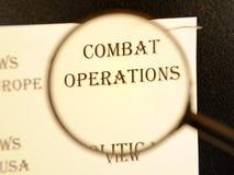 报纸的标题文章`作战行动`的 图库摄影