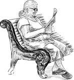 读报纸的老妇人 免版税库存照片
