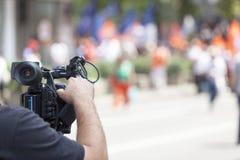 报道事件用一台摄象机 库存图片