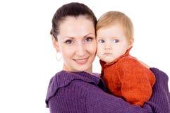 抱着她的胳膊的我的母亲婴孩 免版税库存图片