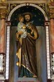 抱着小耶稣的圣若瑟 免版税库存照片