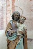 抱着小耶稣的圣若瑟 免版税图库摄影