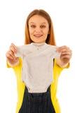 抱着婴孩的孕妇穿戴隔绝在白色 免版税库存图片