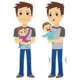 抱着婴孩的父亲 免版税库存照片